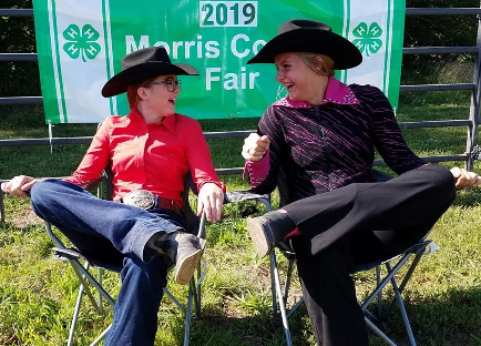Michelle & Delayna relaxing in their embroidered Chair prizes and enjoying their time at the fair!
